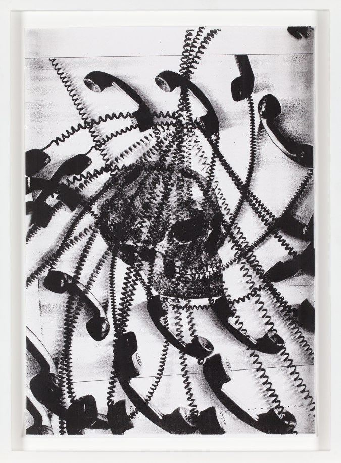 Black-and-white photocopy multiple exposure of corded telephones spiraling out from a skull.