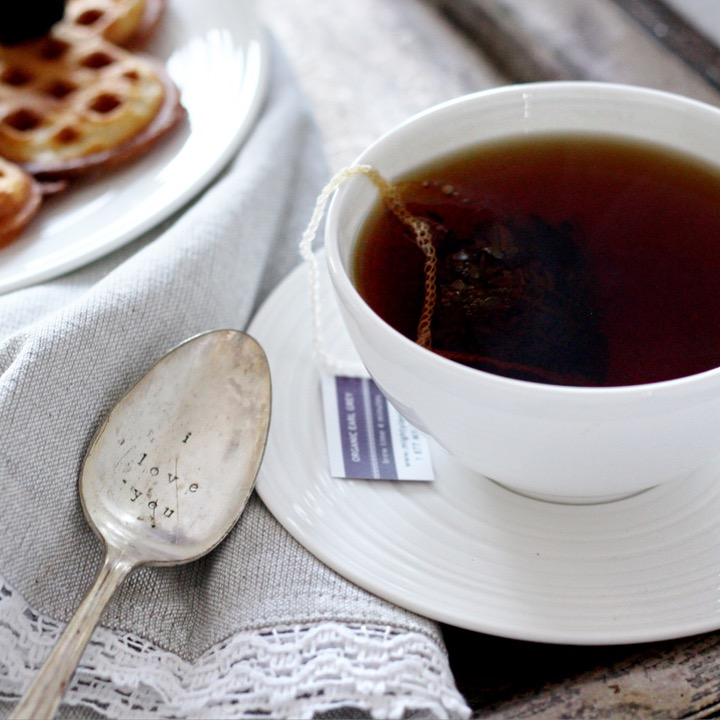 Vanilla Buttermilk Waffles on white plate, cup of tea in white mug on white saucer, I love you more spoon