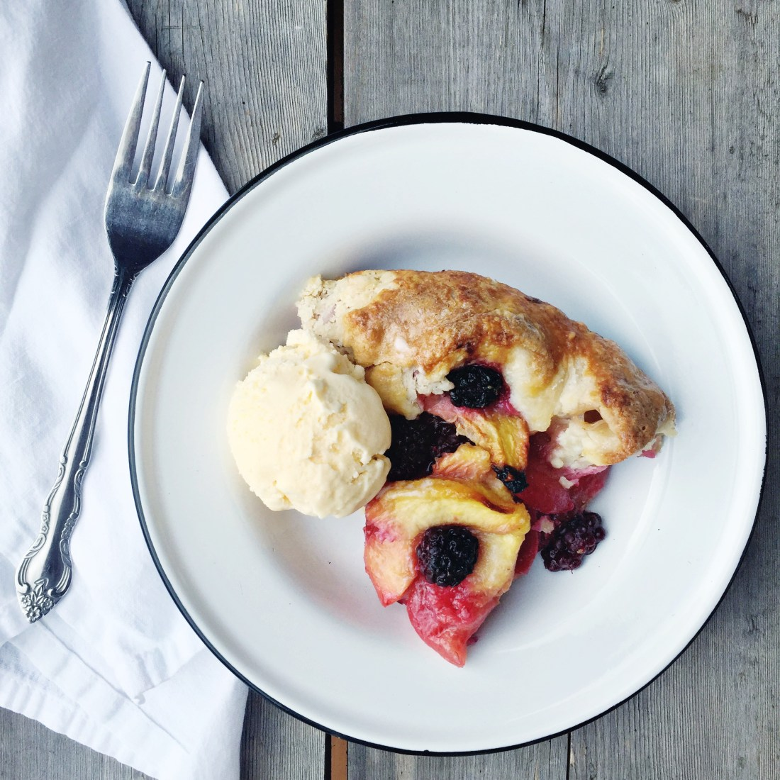 Summer Fruit Galette on white plate with scoop of ice cream