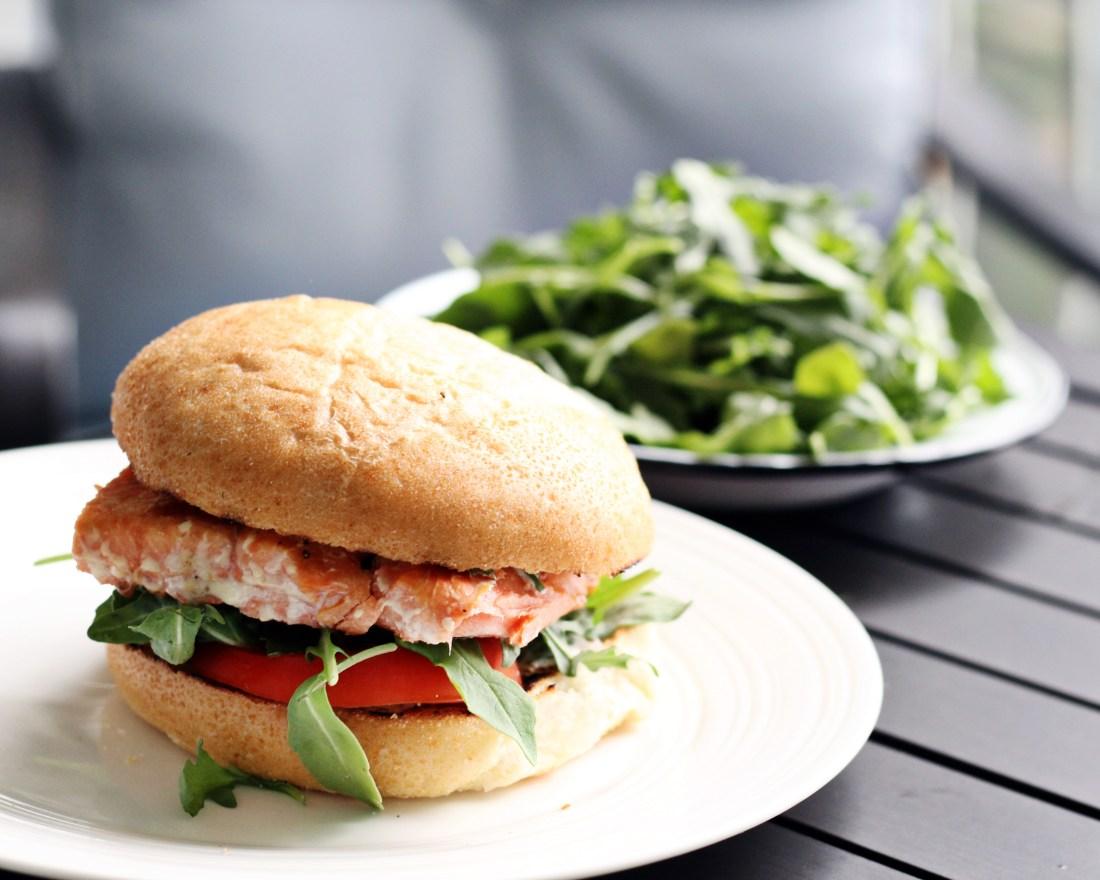 Cedar Plank Salmon Burger on white plate