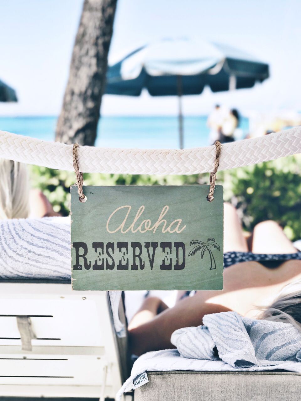 Aloha Reserved sign on the cabana at the Moana Surfrider Hotel in Honolulu Hawaii