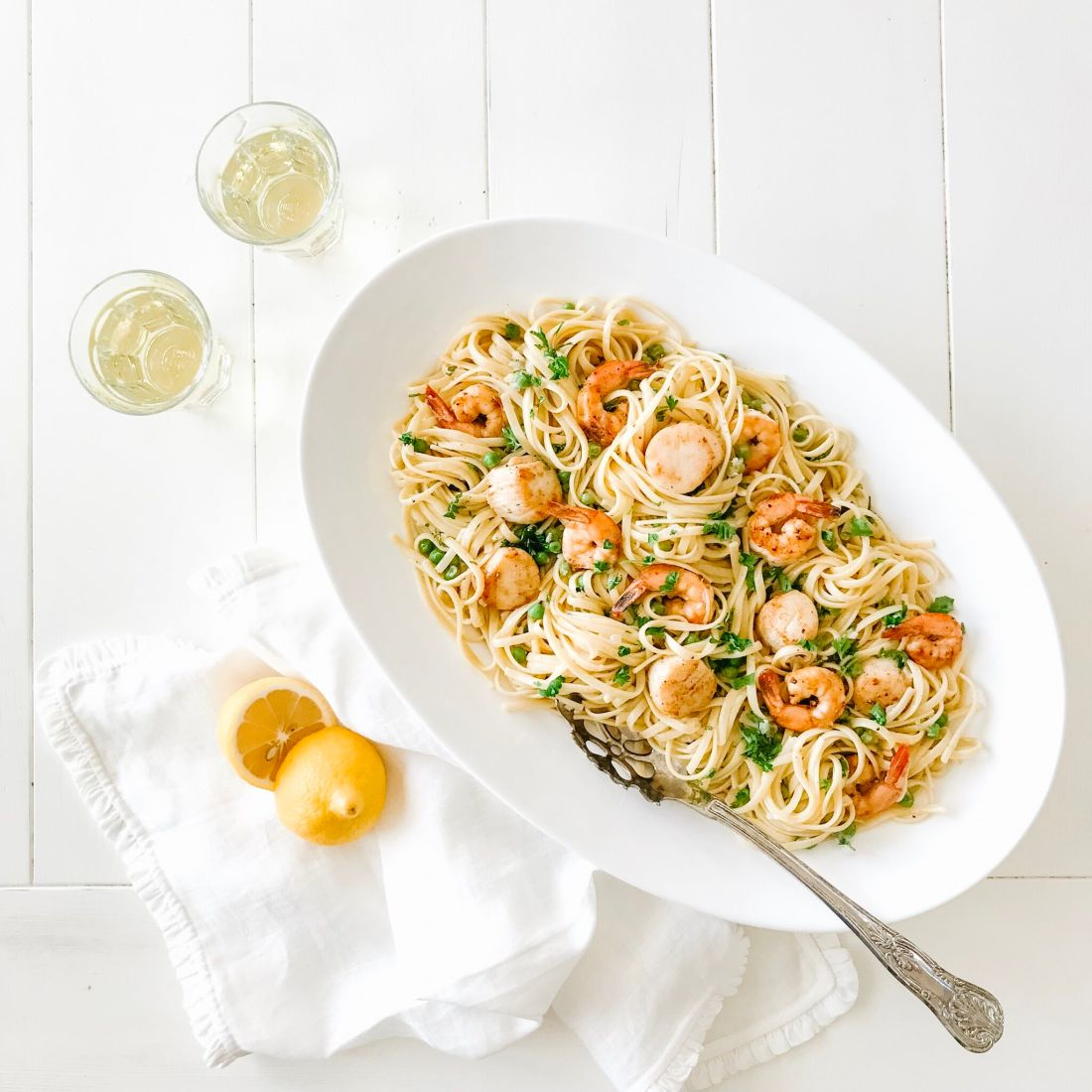 Seafood Linguine in a platter served with crisp white wine
