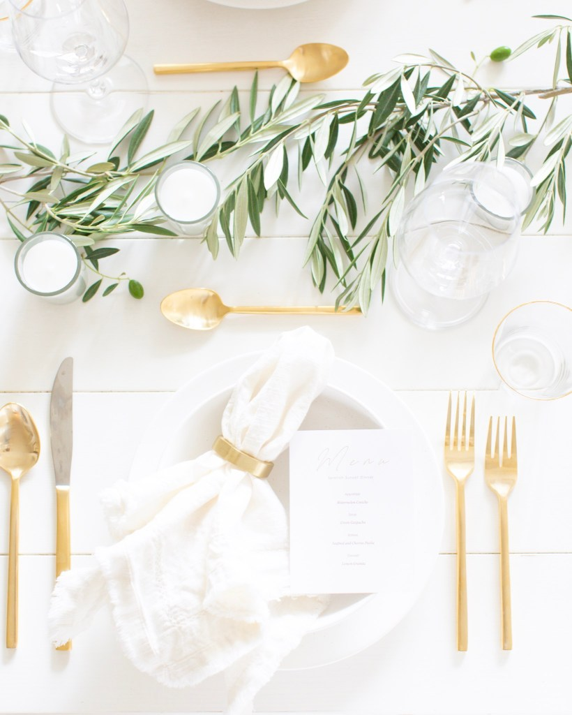 Mediterranean Dinner Party complete with wine paired menu and olive branches on the table with a hostess schedule and grocery list!