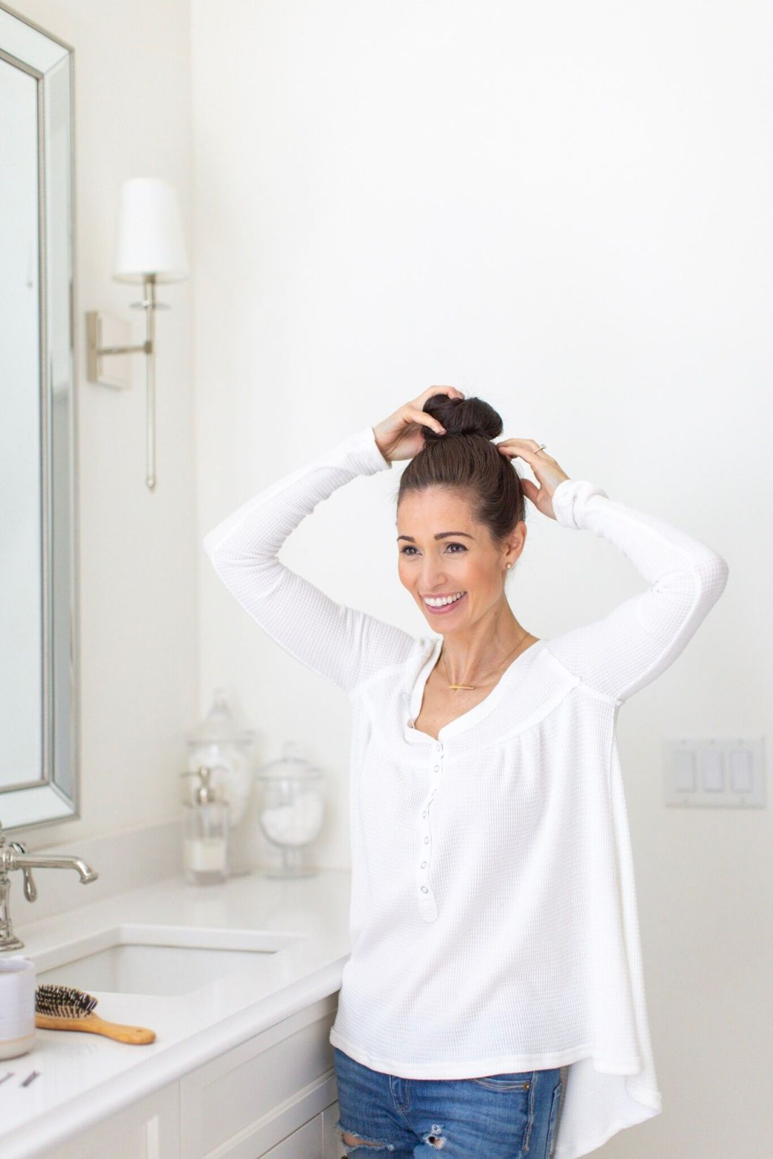 How to put your hair up in a quick and easy bun by blogger Tori Wesszer of Fraiche - my Mom bun hack
