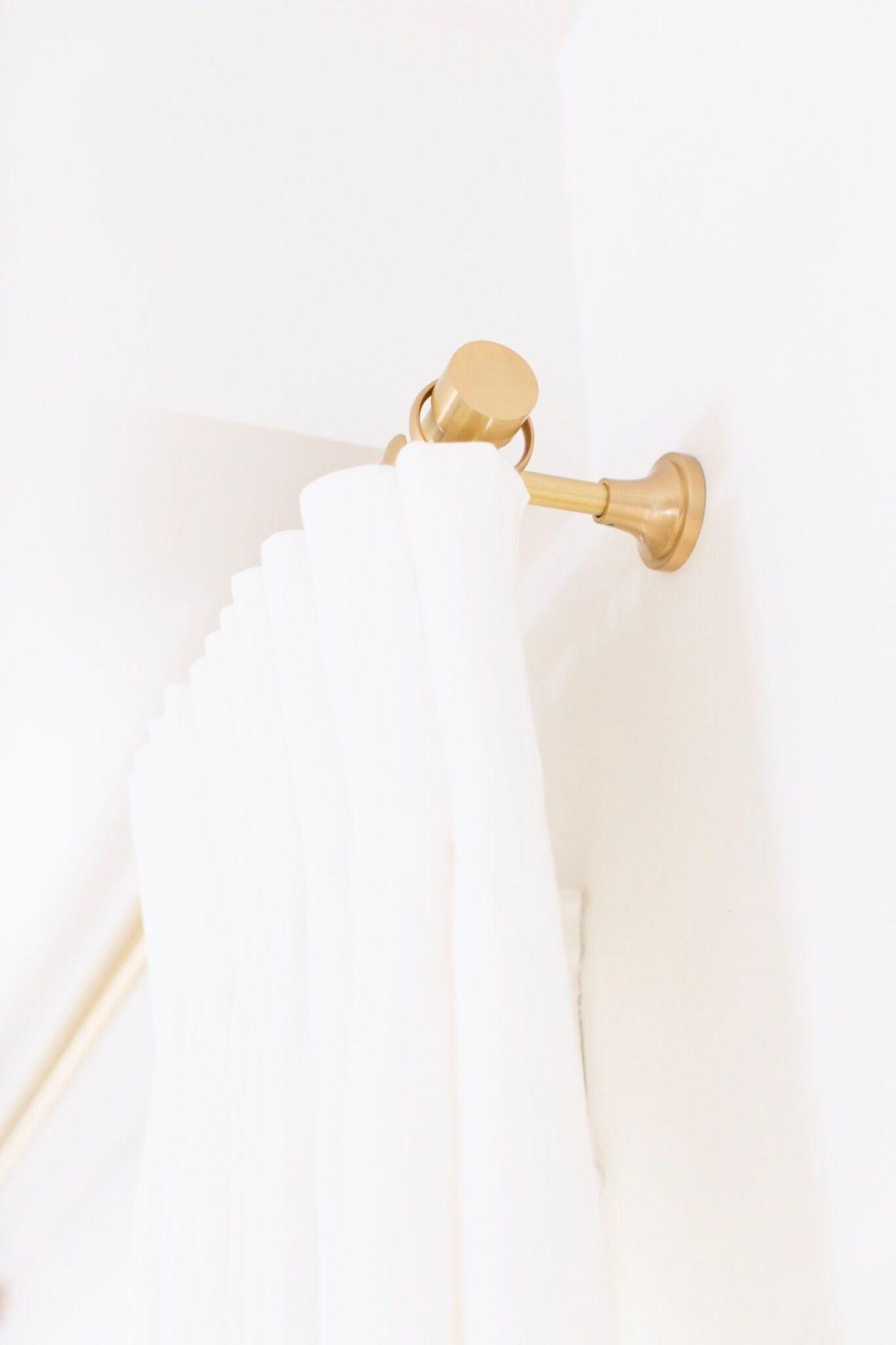 Gold Hardware for White linen drapes from Q design centre