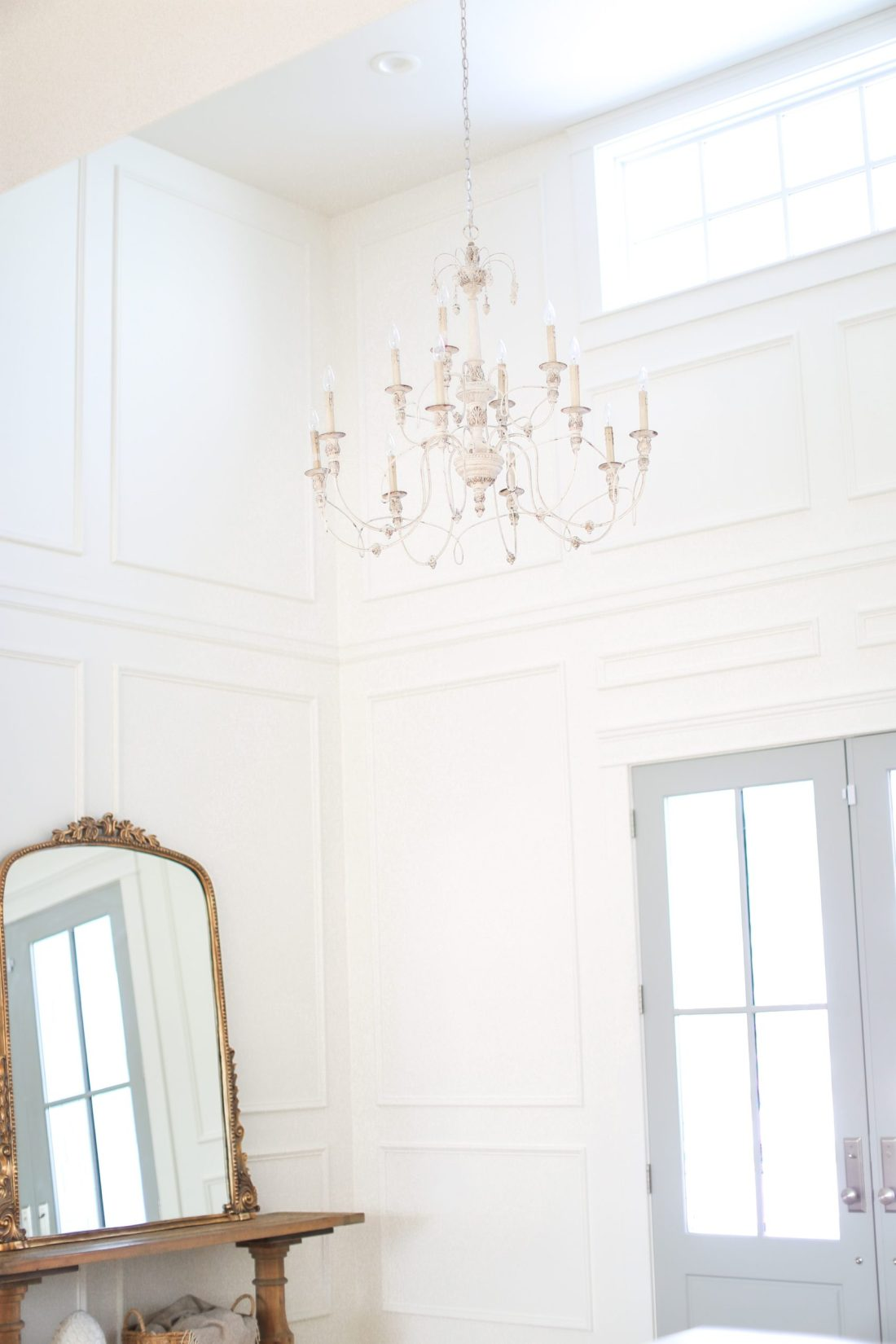 Oversized chandelier in vaulted entry way