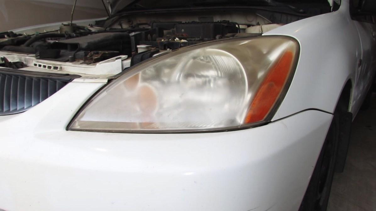 Before headlight restoration on Mitsubishi Lancer