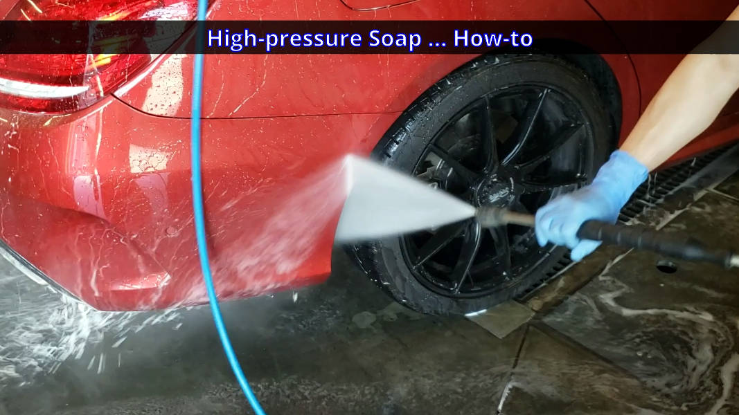 Using spray wand to wash dirtiest parts of the car
