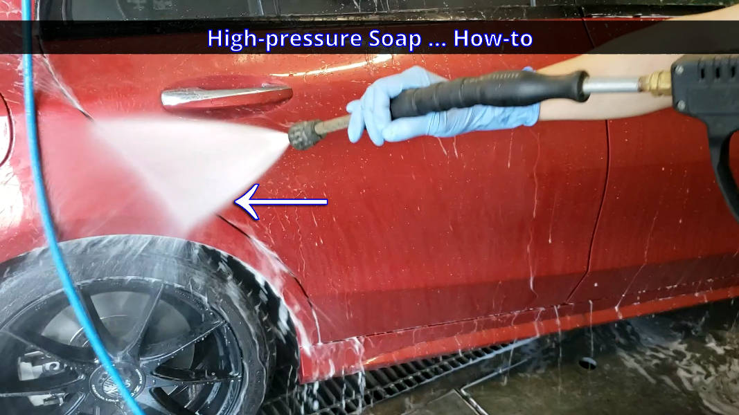 Using spray wand to wash the door jambs of the car