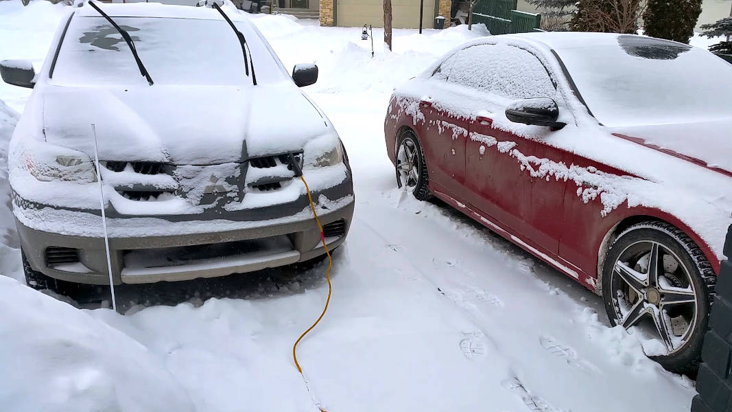 Car and SUV block heater plugged in during winter