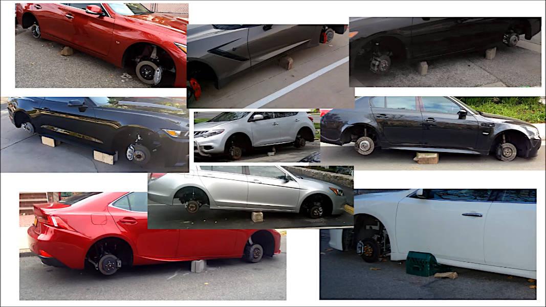 Cars with stolen wheels left on bricks