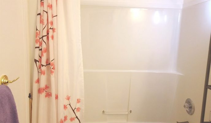 Bathroom with soap scum, mineral deposits and mildew to be cleaned