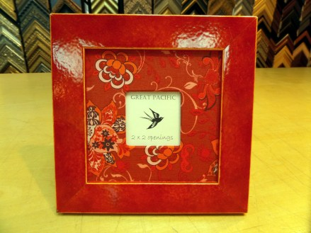 Red frame with red flower fabric.
