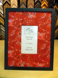 Black frame with flower fabric.