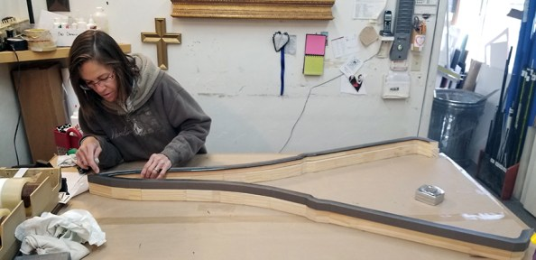 Francine Hackerott working on bomber frame