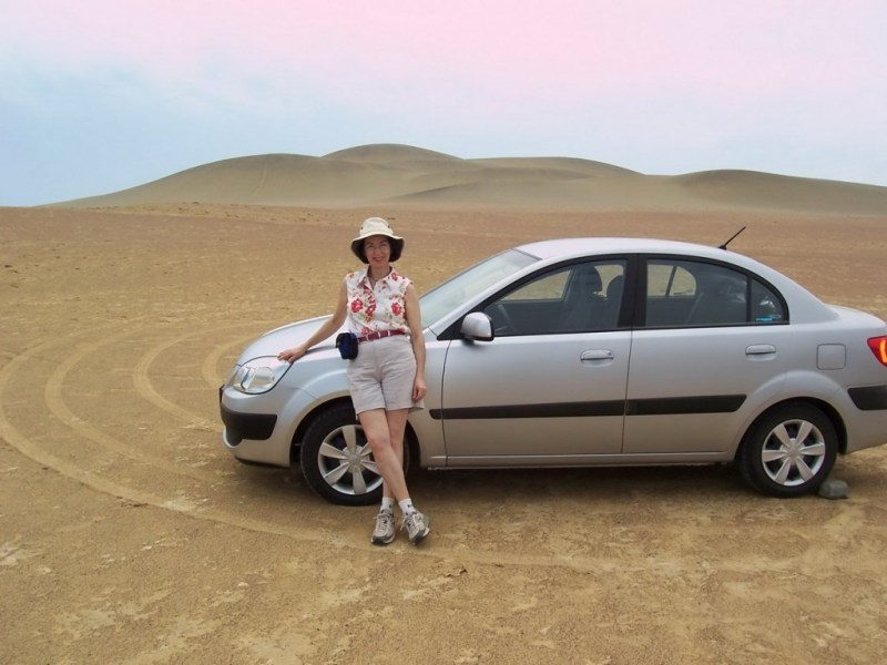 Jean beside our rental car in National Reserve of Paracas - Peru