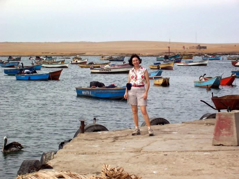 Jean on the dock at Playa Lagunillas in Paracas National Reserve, Peru