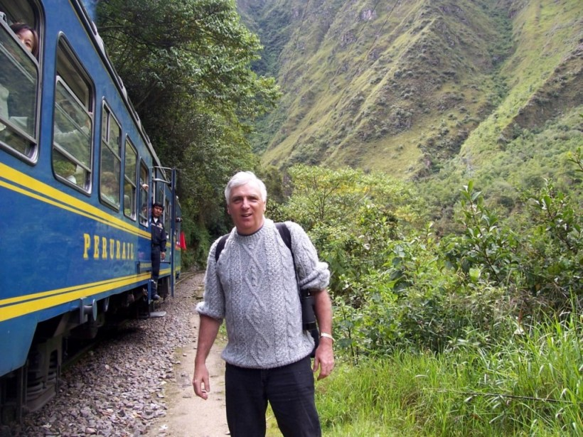 Bob exits PeruRail train at Chachabamba on the Inca Trail in Peru, South America
