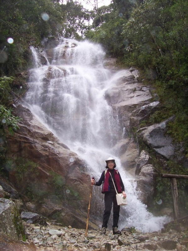Jean at the waterfalls near the Wiñay Wayna ruins on the Inca Trail in Peru, South America
