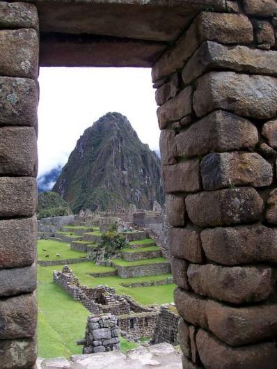 An image of Machu Picchu through the main stone gate in Urubamba Province, Peru.