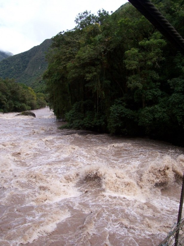 Raging flood waters on the Urubamba River in Peru, South America