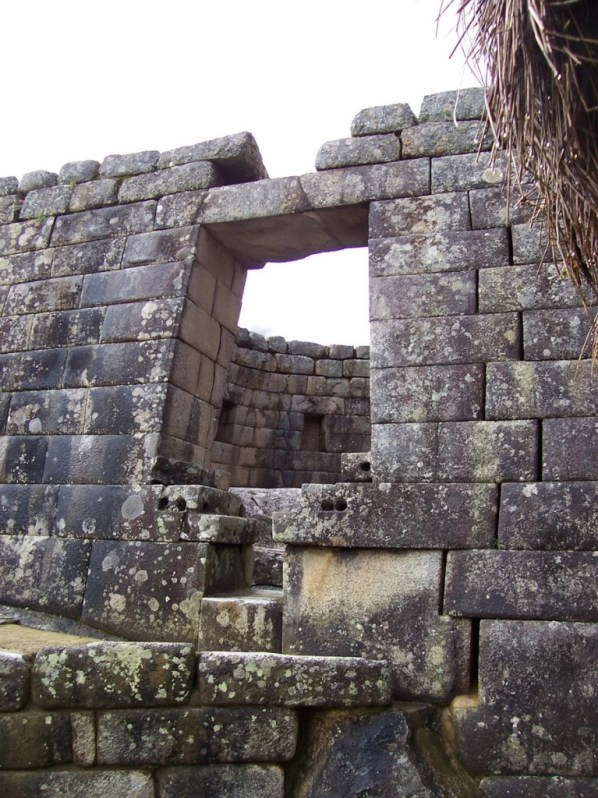 An image of the window in the Tower of the Sun at Machu Picchu in Urubamba Province, Peru.