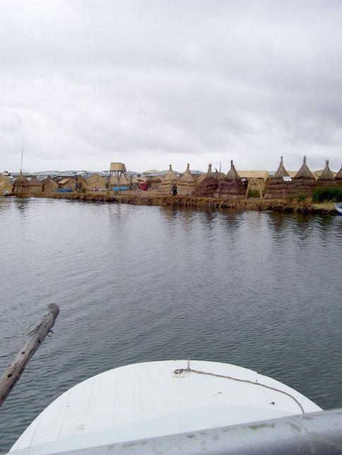 aboarding uros floating island, lake titicaca, peru