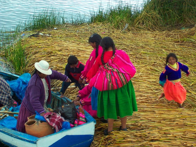 uros women at market boat, lake titicaca, peru