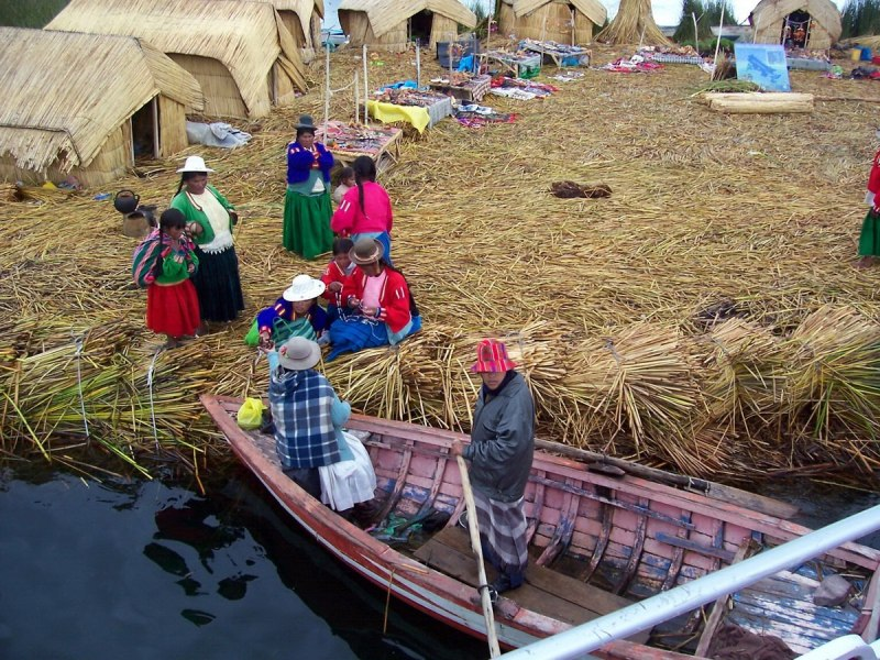 uros women on floating island, lake titicaca, peru