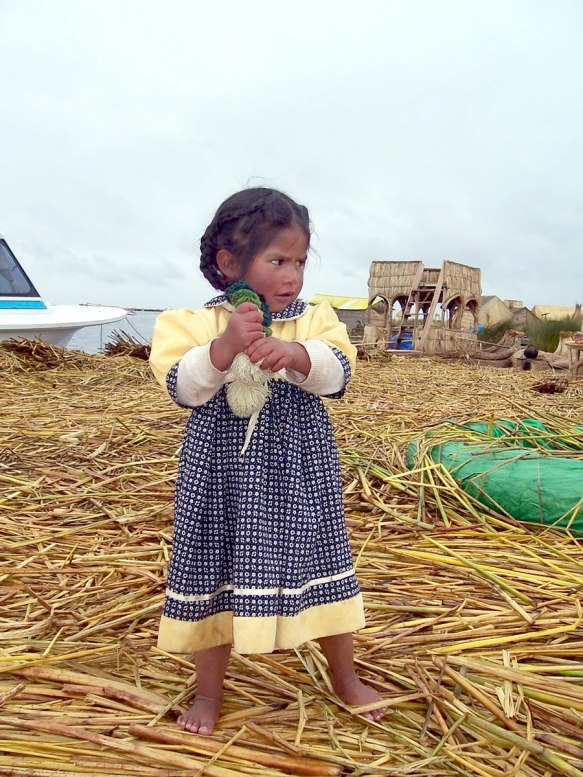 young uros girl, floating island, lake titicaca, peru