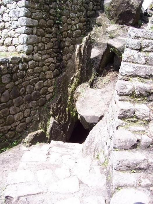 Entrance to a tunnel on hiking trail up Huayna Picchu mountain, Machu Picchu