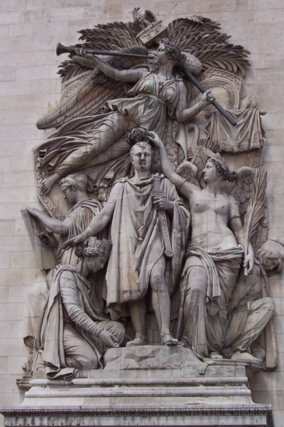A closeup image of the Le Triomphe of 1810 sculpture on a pillar of the Arc de Triomphe in Paris, France.
