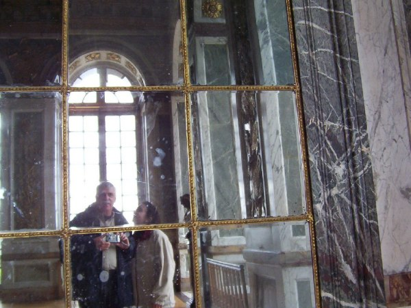 An image of Jean and Bob in the Hall of Mirrors at the Palace of Versailles in France.