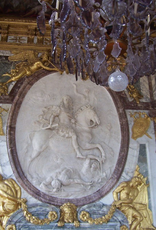An image of the Salon de la Guerre Bas Relief in the Hall of Mirrors at the Palace of Versailles in France.