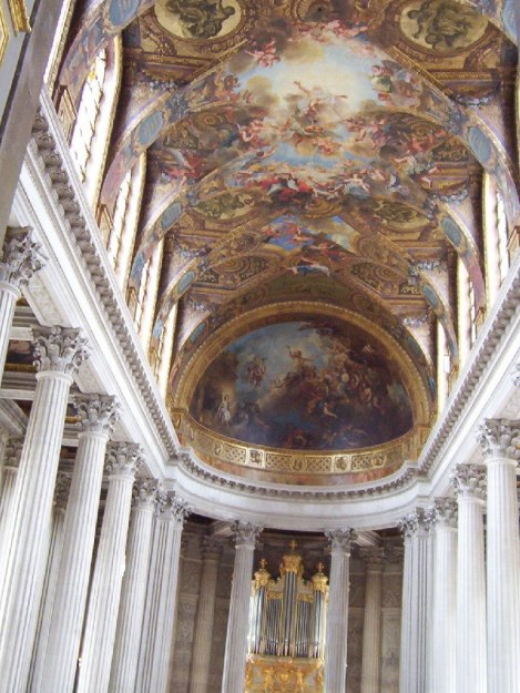 An image of the pillars and painted ceiling in the Royal Chapel at the Palace of Versailles in France.