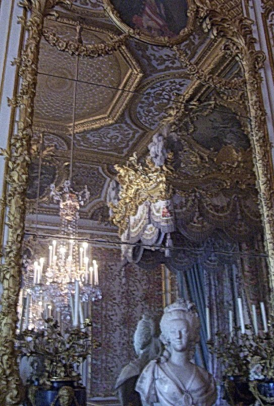 An image of a mirror in Marie Antoinette's bedchamber at the Palace of Versailles in France.