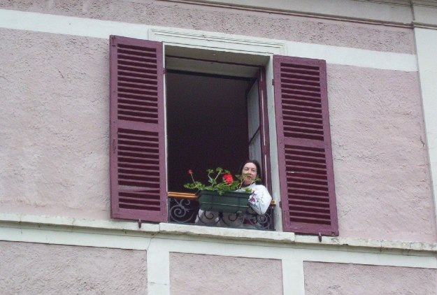 Jean looking out from our hotel room window in Giverny, France