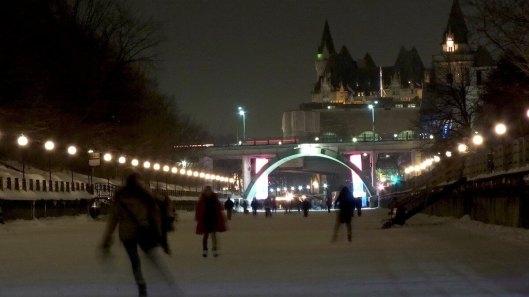 Skating on the Rideau Canal at nighttime - Ottawa - Canada