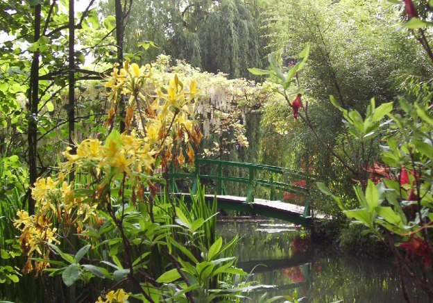 An image of the green bridge in Claude Monet's water lily pond in Giverny, France.