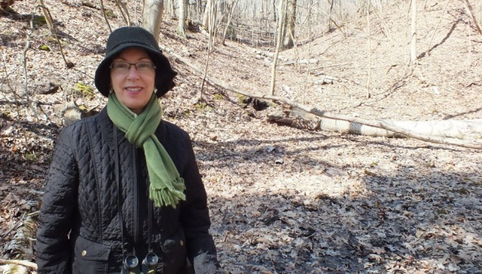 Jean stands beside Skunk Cabbage plants in Hamilton - Ontario
