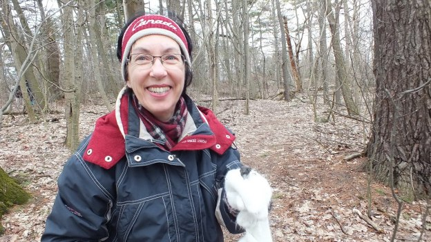 Jean with bird skull on her mitten - thicksons woods - whitby - ontario