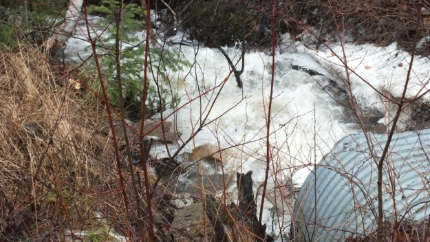 Oxtongue Lake flooding - fast moving water from distant hills - April 20 2013