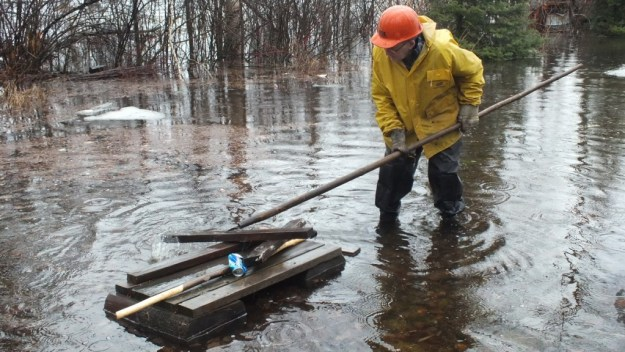 Oxtongue Lake flooding - marvin puts new hip waders to good use - April 20 2013