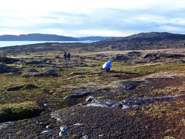 Hiking with Inuit guide on Kekerten Island in the Cumberland Sound, off Baffin Island, Nunavut, Canada