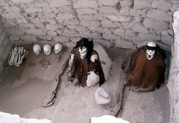 Human skulls and bones in an open gravesite at the Chauhilla Cemetery near Nazca in Peru, South America.
