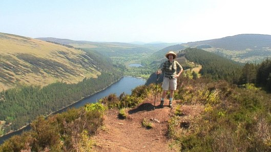 jean stands above upper lake - glendalough - wicklow mountains national park - ireland