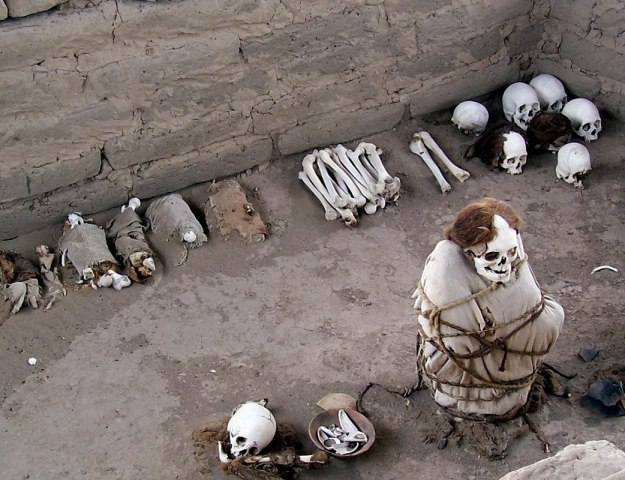 Human Mummified body and skulls and bones at the Chauchilla Cemetery in Peru, South America
