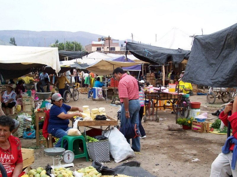 shoppers in street market - nazca - peru