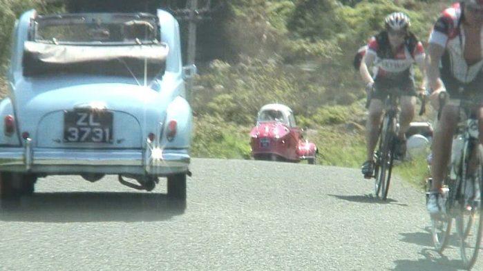 three wheel car and bikers