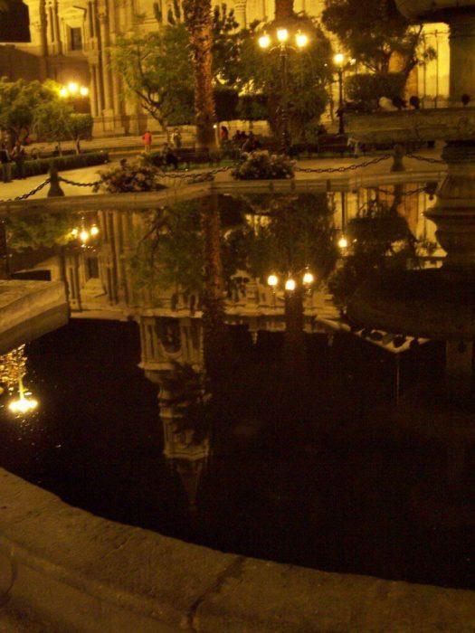 Reflections in water, Plaza De Armas, Arequipa, Peru